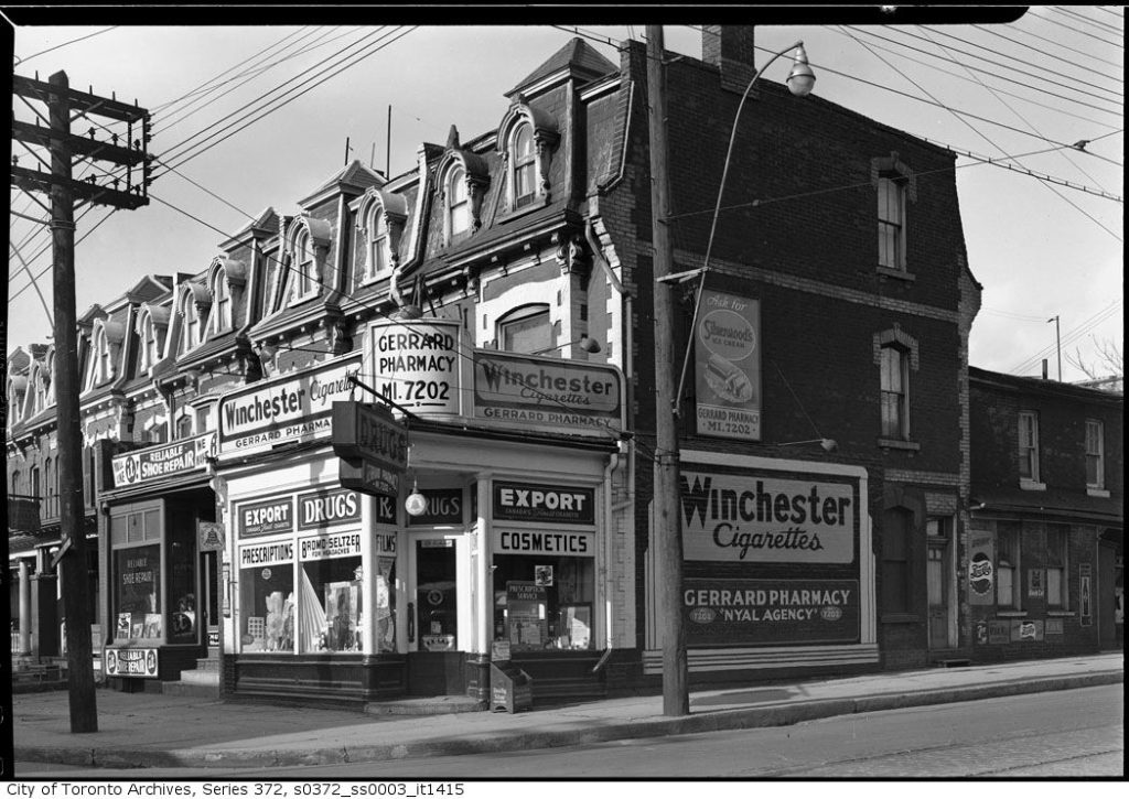 Black and white photo of a variety store and shoe repair shop in 1947.
