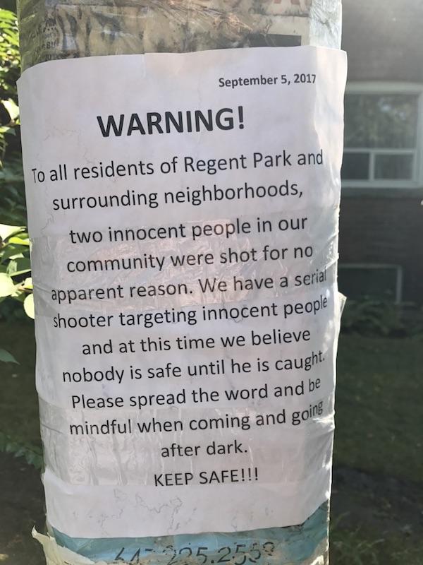 Poster warning of random shootings in the neighbourhood