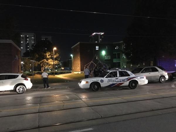 Image of police car in front of crime scene